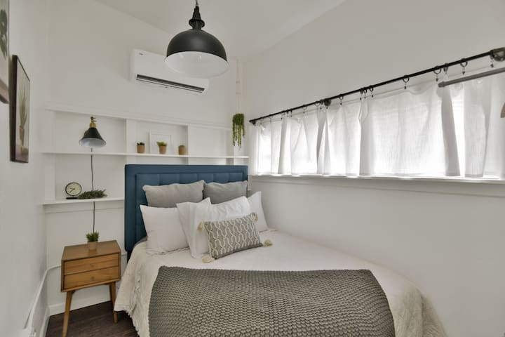 Comfy full size bed, luggage rack and a small rod for you to hang clothes.