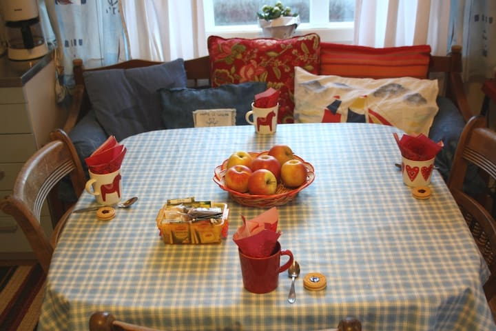 The kitchen table is welcoming you and we wish that you feel like at home!