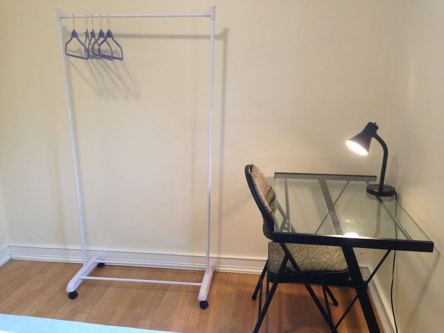 Desk and chair, and clothes stand in your private bedroom