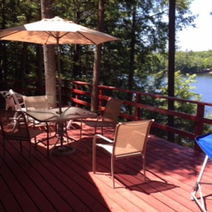 Spacious deck in the afternoon, includes lounge chair and hammock