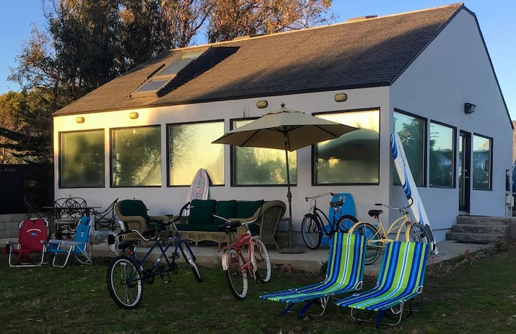The front of the guest house showing off  lots of the beach toys, bikes, lounge chairs, beach towels, etc for your enjoyment.