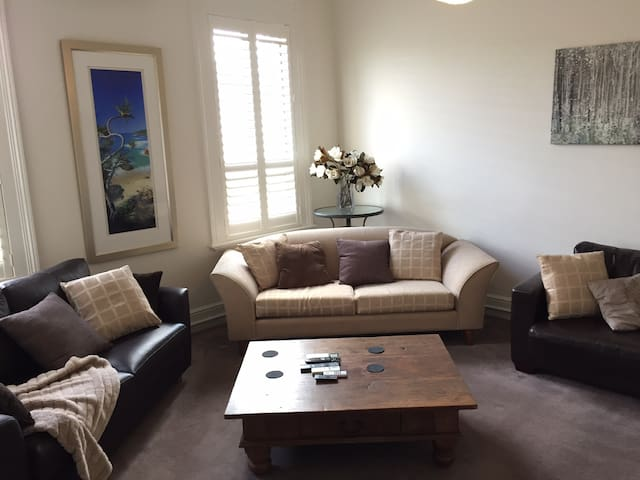 Lounge room includes two leather double sofa beds which can sleep an additional 4 people