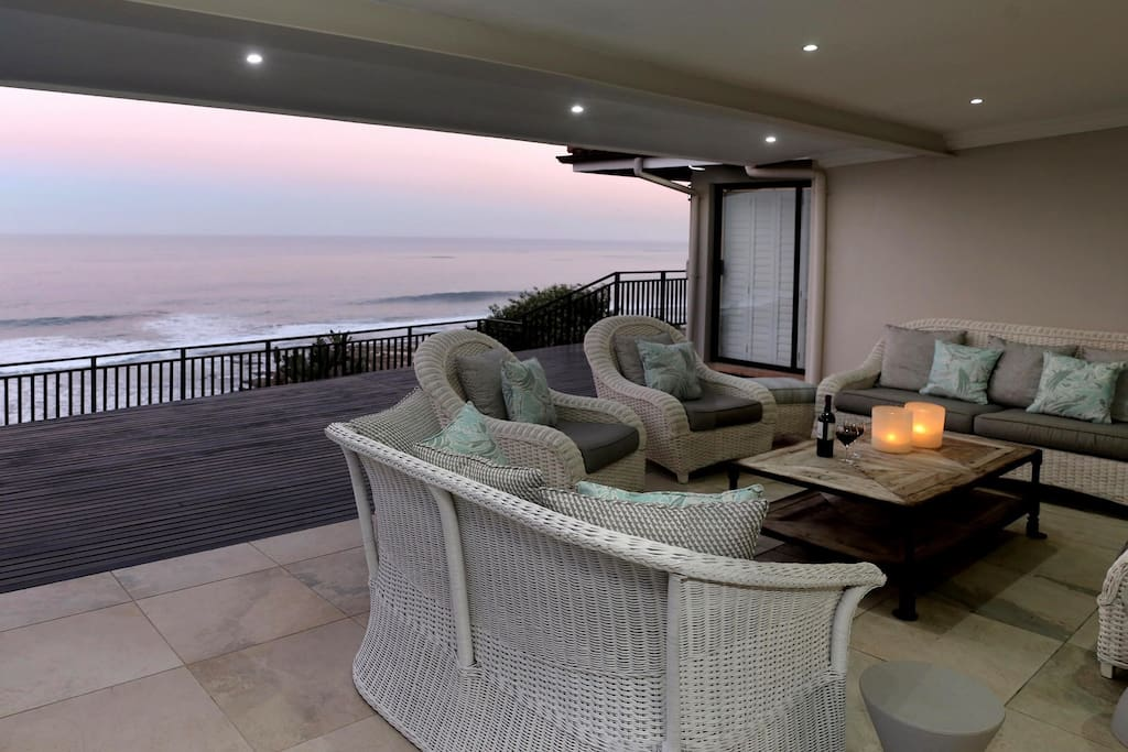 Covered patio and deck overlooking the ocean