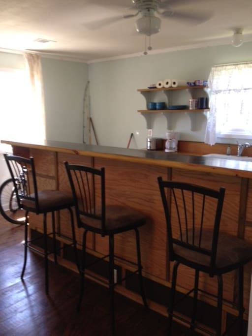 3 bar stools and dining counter.