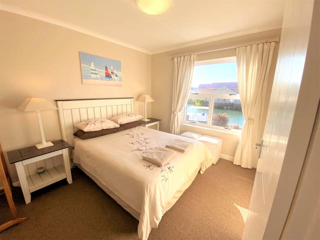 Main bedroom with ensuite bathroom and stunning view over the canal