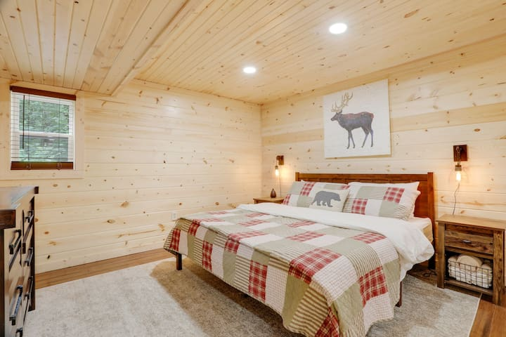 Basement bedroom is a true oasis with a king bed, sound machine, essential oil diffuser and table fan.