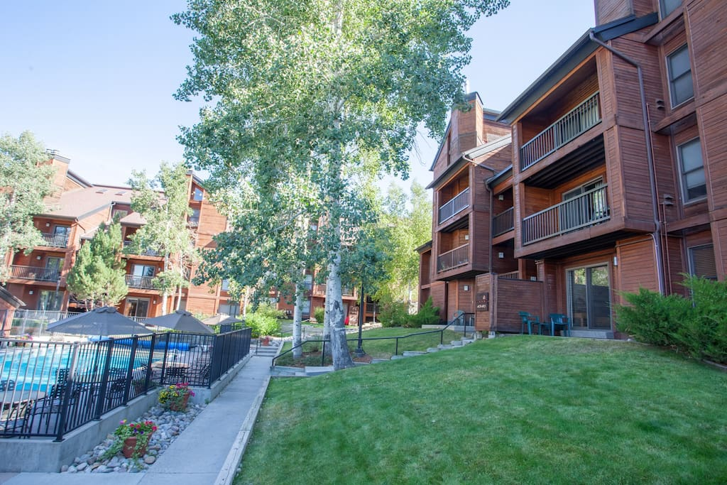 Unit 408 is in the building to the Right in this photo, overlooking the year-round heated pool and tennis courts