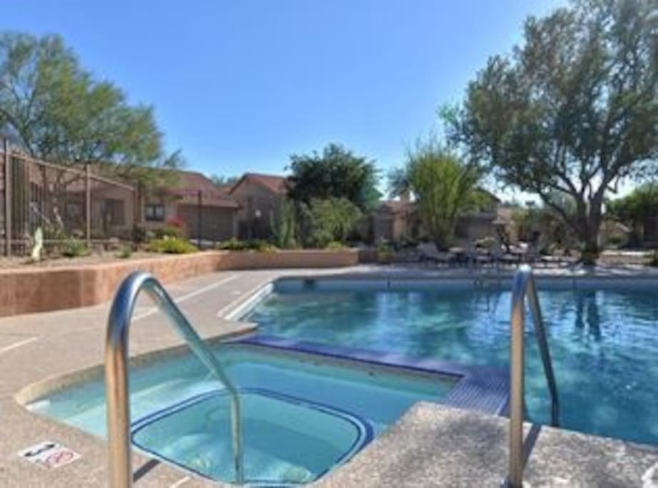 Community pool, hot tub and outdoor kitchen and lounge area steps from the house.