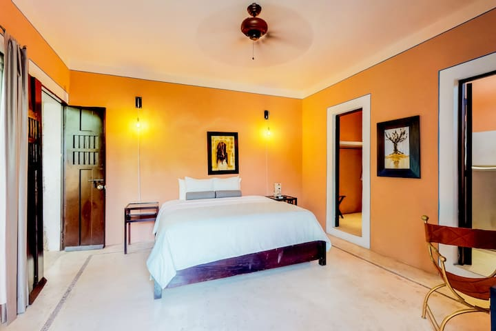 Colorful hacienda suite in city center with shared pool and gardens!