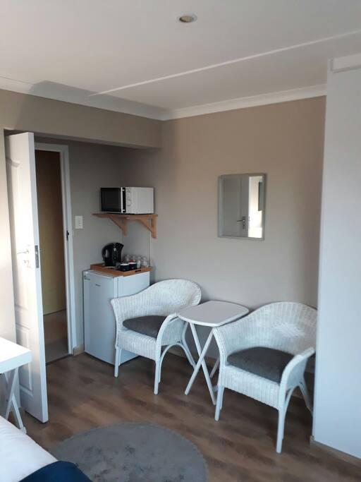 Main bedroom has bar fridge, microwave, aircon and TV