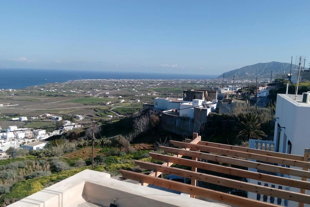 The south side of Santorini coast line towards Kamari (Ano Vourvoulos) from the balcony of the apartment.