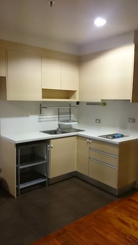 Fully equipped kitchen, washing machine, and microwave.