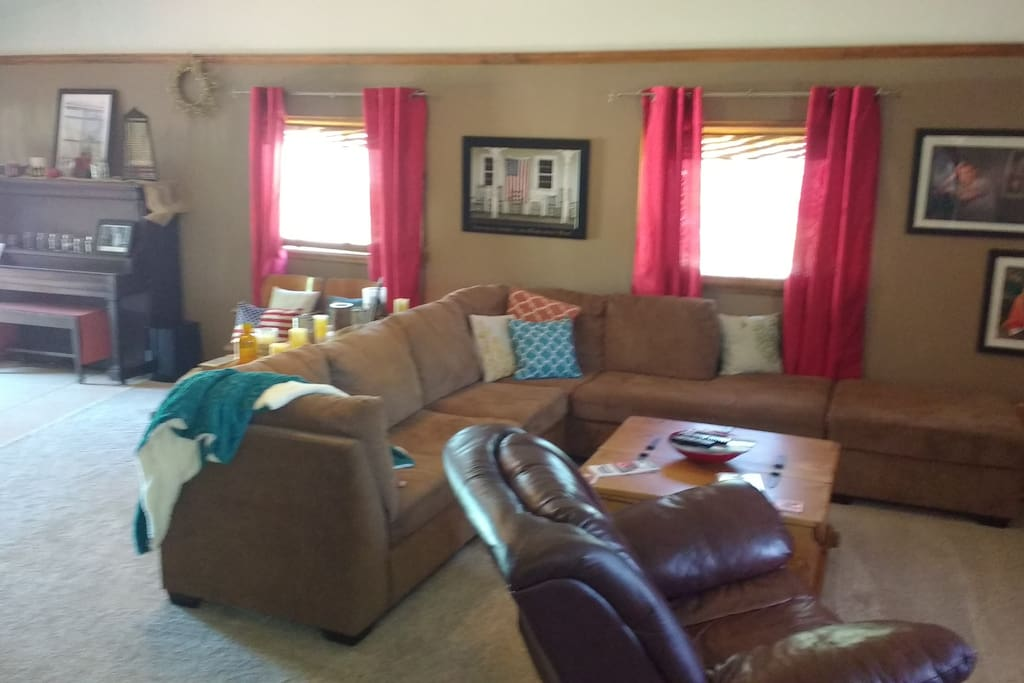 Plenty of space in the family room with a bar and bug screen tv