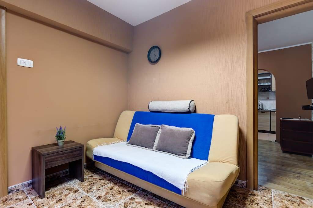 On the entrance into the apartment, there is a comfortable sofa with coffee table. Warm tones in this corner will definitely create friendly atmosphere among our guests.