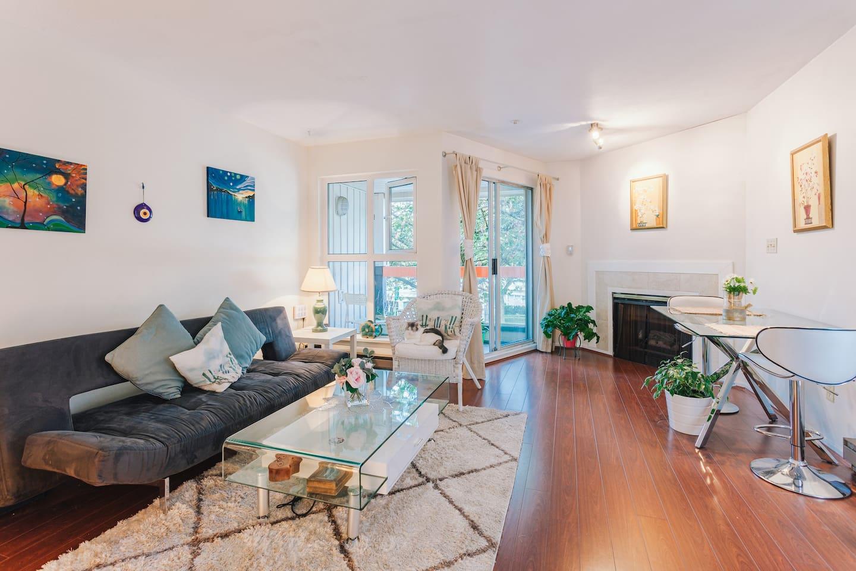 Beautiful top floor living room with plenty of light, plants and patio :)