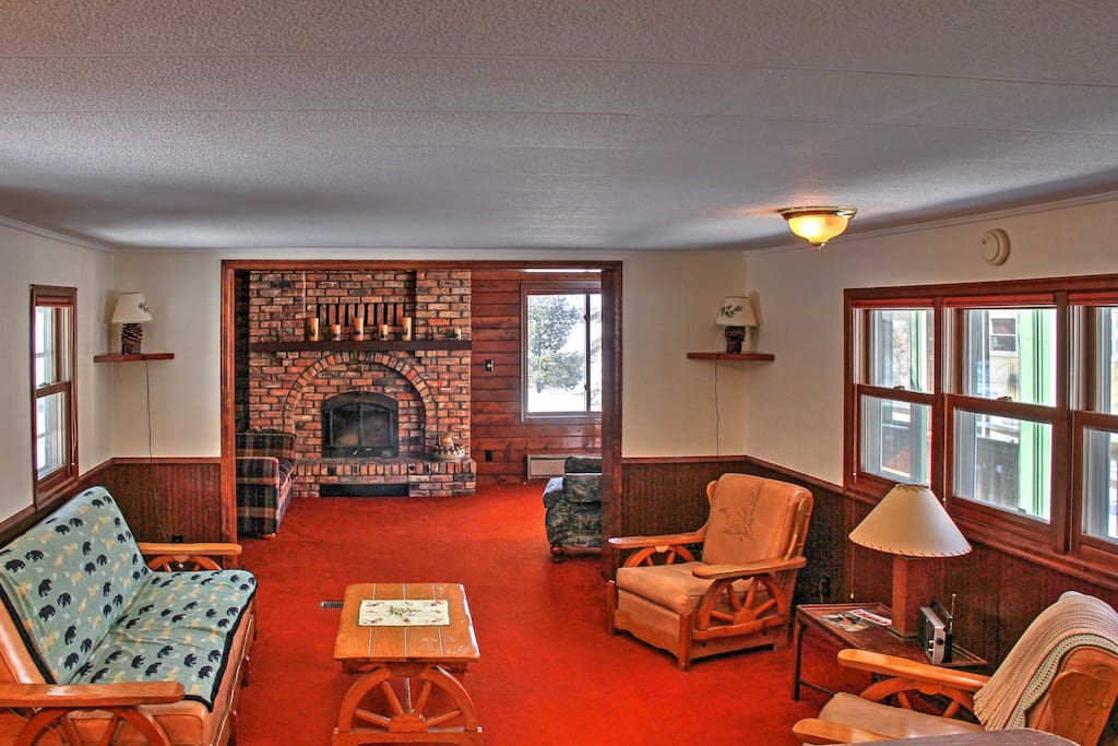 Inside the main cabin, you'll find comfortable furnishings & a brick fireplace.