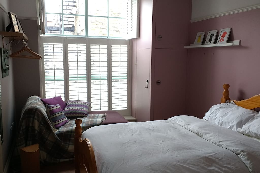 The lovely chaise-longue by the window. See the gorgeous large shutters! Great for letting light in and for blocking it out.