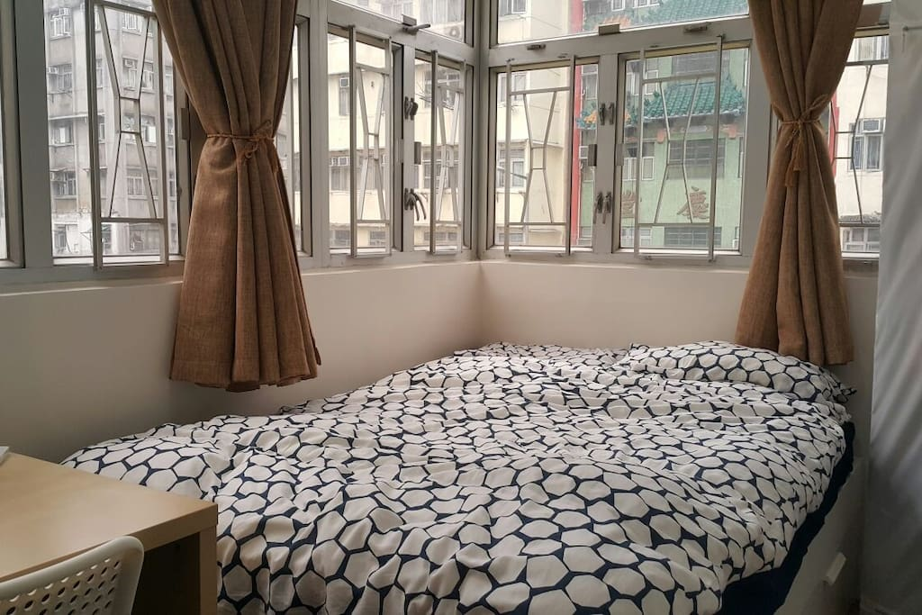 This is the room you are booking. Enjoy a view of the neighborhood.