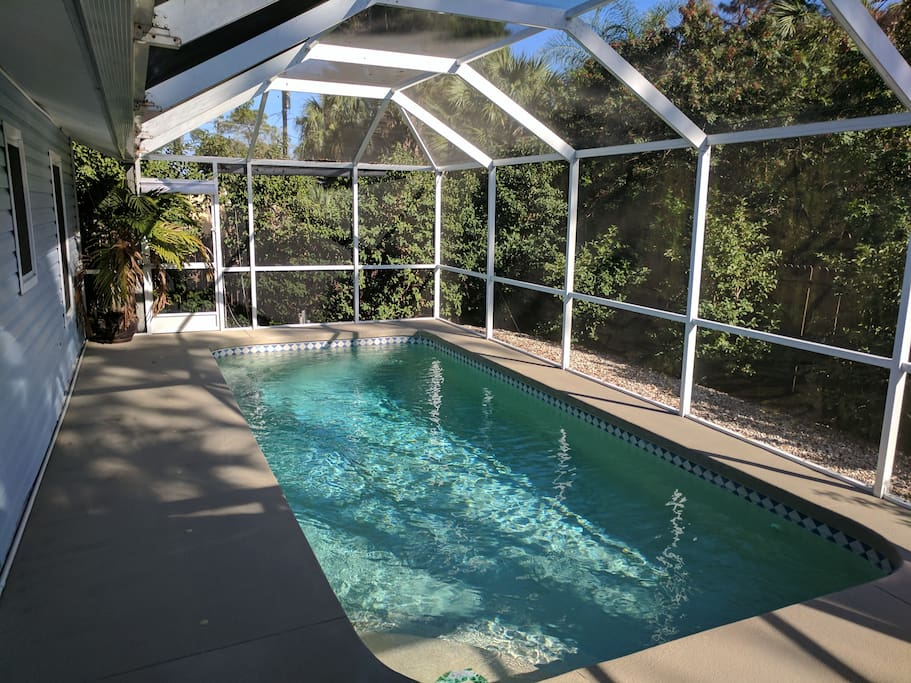 Private heated pool in total seclusion with an outer privacy fence and protected by a lanai.