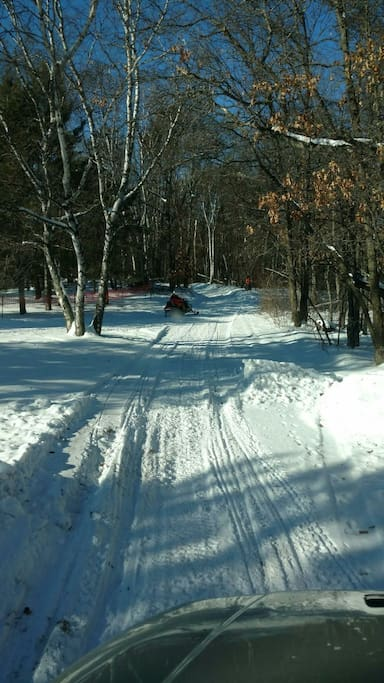 Entrance to snowmobile trails from side yard!