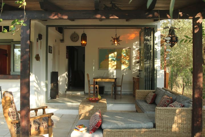 Outdoor lounge area - concertina door allows you to merge inside & outside