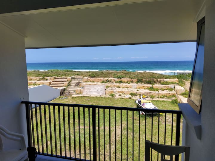 Newly renovated beach house metres from the water