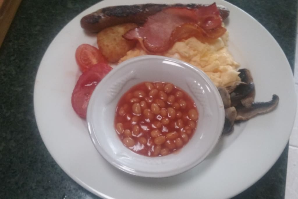 English breakfast with scrambled eggs