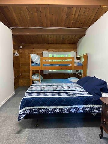 Second bedroom with double bed and twin bunk beds