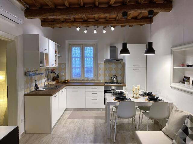 Modern home in front of the Arno river