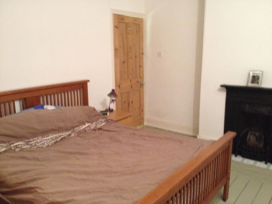 A spacious double bedroom with a king sized bed