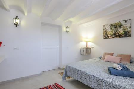 Minimal room in Bohemian Villa.