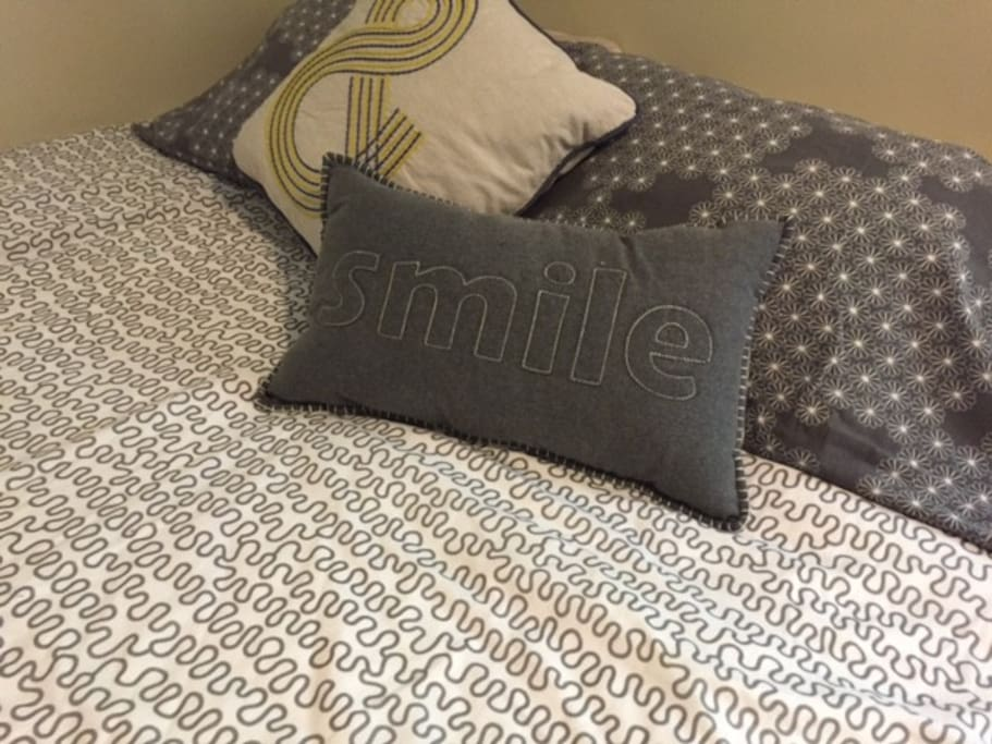 Snuggle up and SMILE on queen in main bedroom.