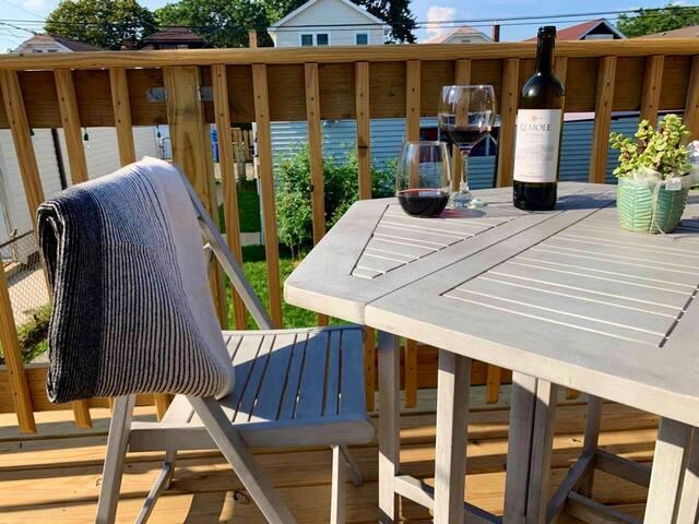 Sunny backyard seating on shared deck