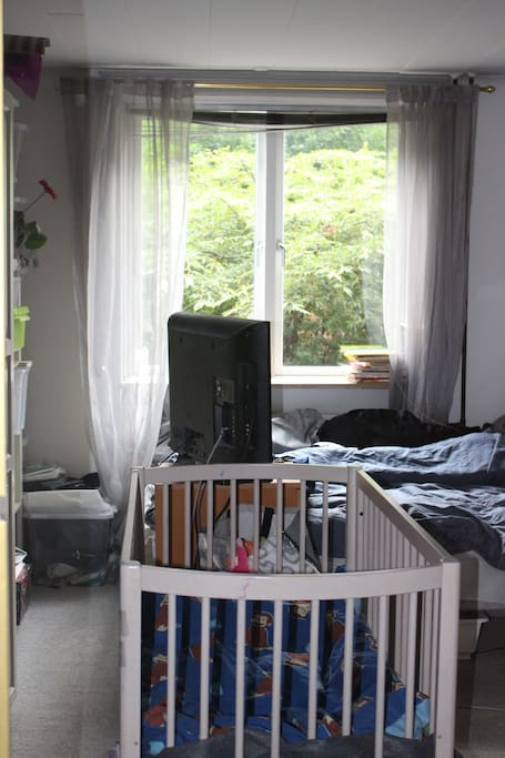 Bedroom with a cot and a changing table.