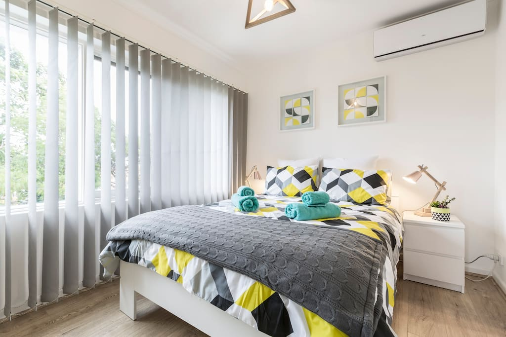 Modern and comfortable bedroom with an ensuite and an air conditioner to keep you warm in winter and cool in summer