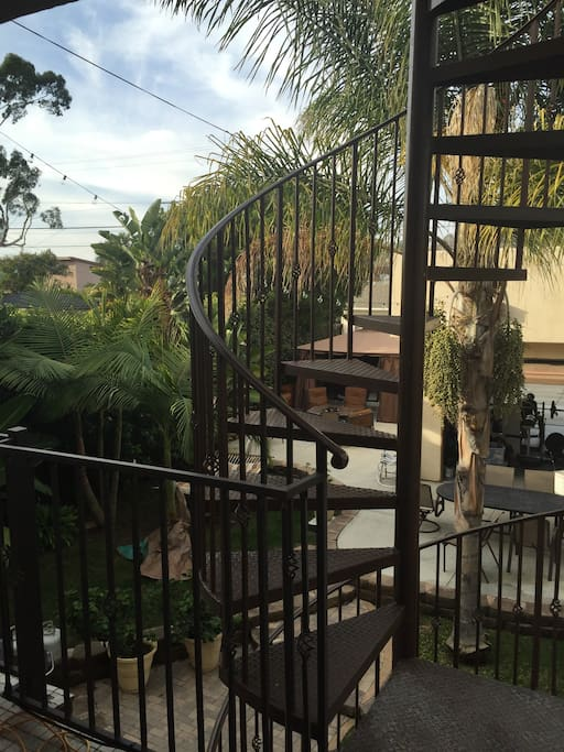 Great view from room with spiral staircase to the roof or backyard