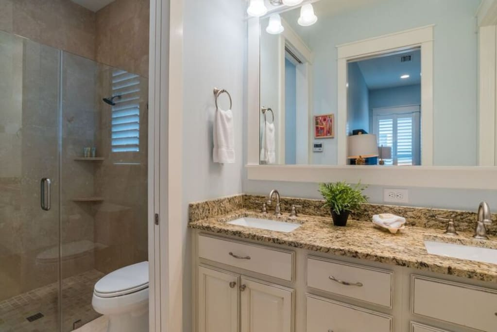 En-suite Bathroom with double vanities, large shower and walk-in closet