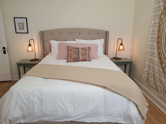 First bedroom - Queen bed, smart TV, closet