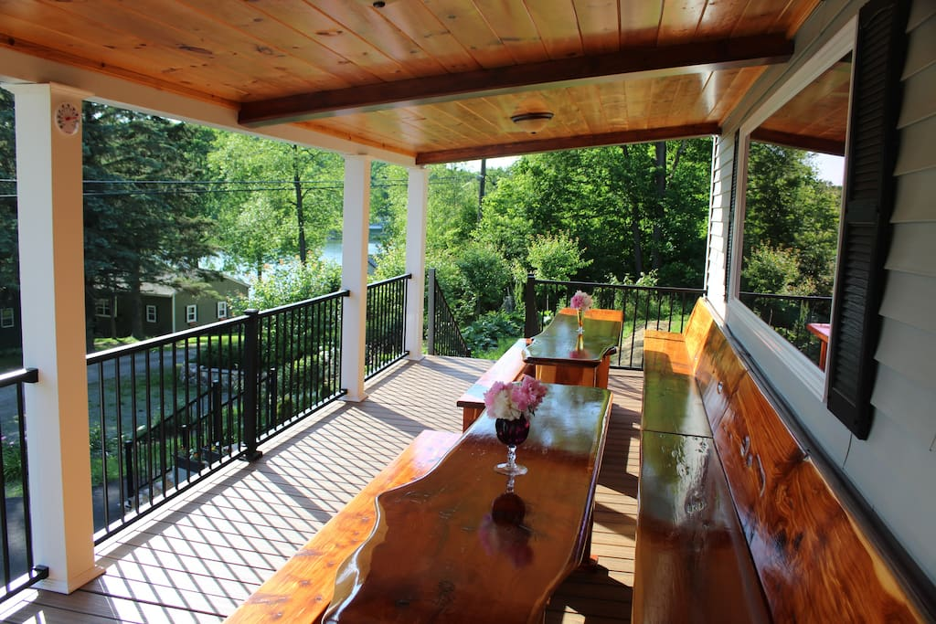 Red Ceder dinning area on cover deck of the house with view to the lake.