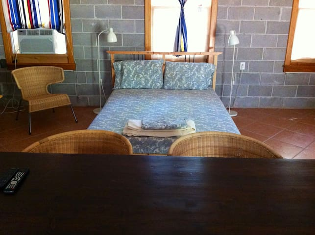 Cabin has 2 queen beds, leather couch, tv/DVD, 10cf refrigerator, private tile bath with talavera sink.