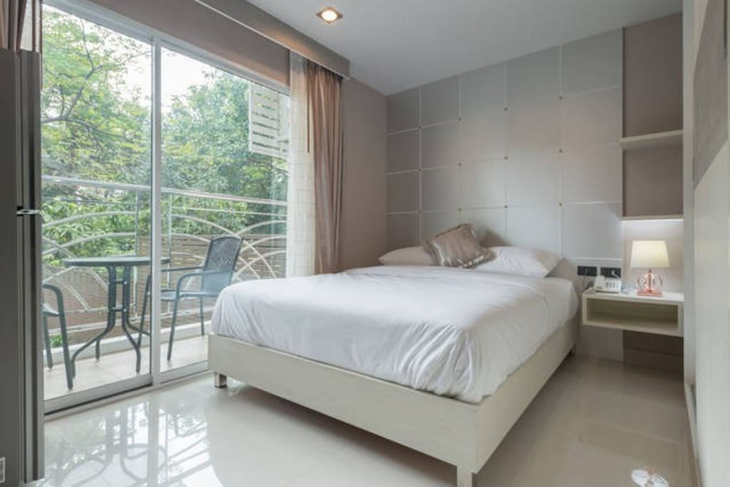 Bedroom with small balcony