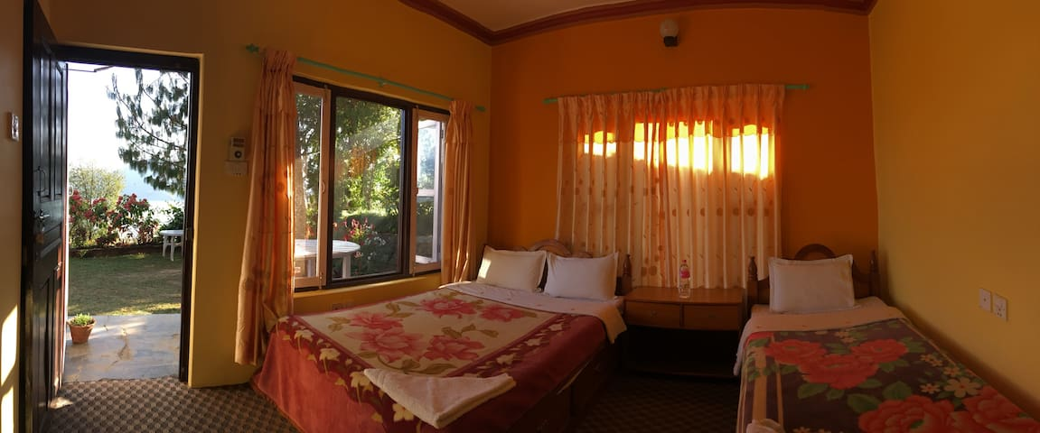 Standard room with 1 double bed and 1 single bed.