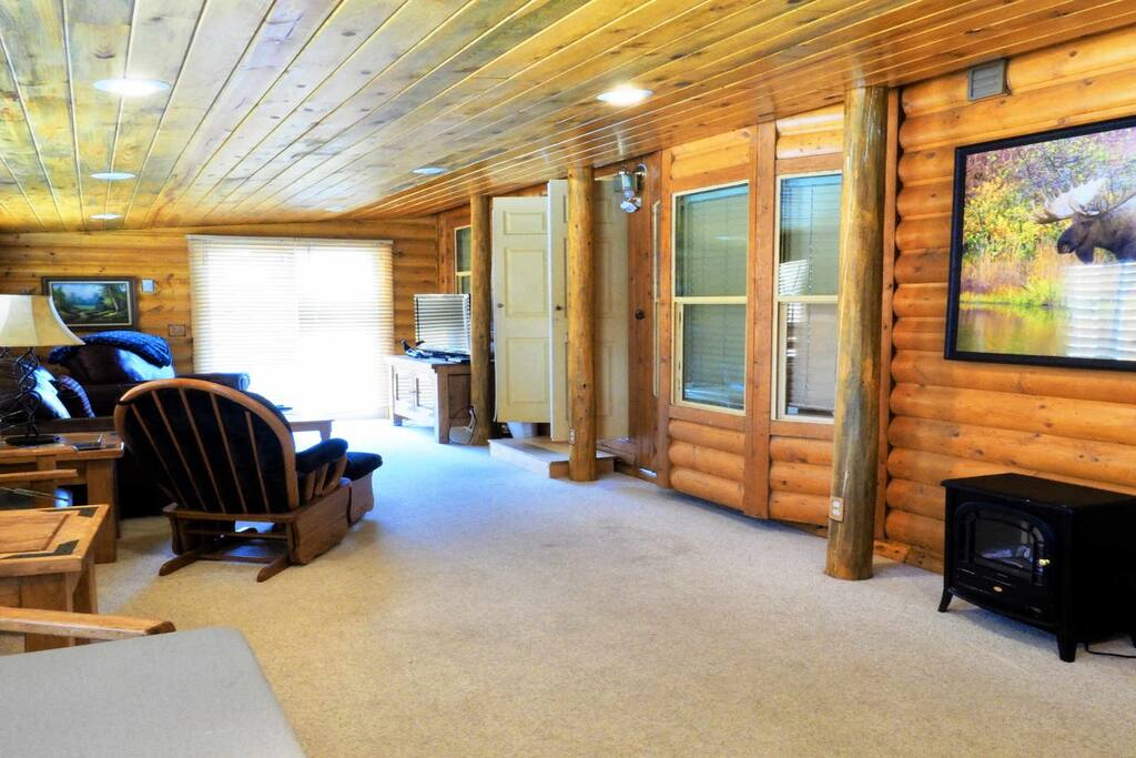 Large Colorado Room with Sleeper Sofa; now has laminate wood flooring