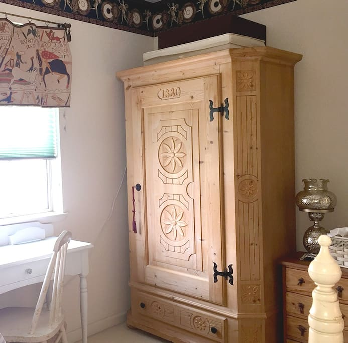 Armoire with hangers to house your clothes