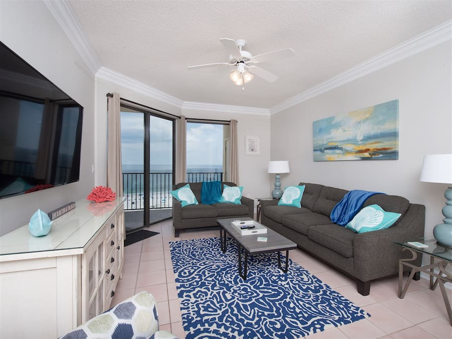 Family room with queen sleeper sofa, recliner, 60' tv, balcony/ocean view