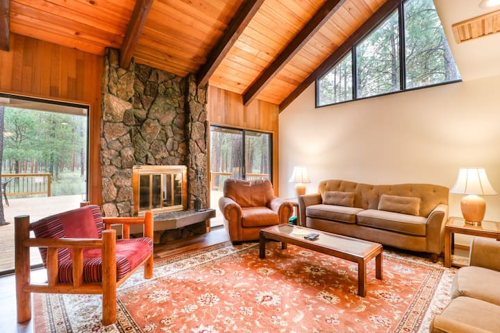 Family getaway w/ wood-burning fireplace, deck, 3 bikes & forest views!