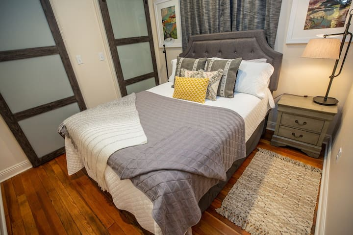 Private bedroom features queen bed , contains hanging clothes closet and washer dryer