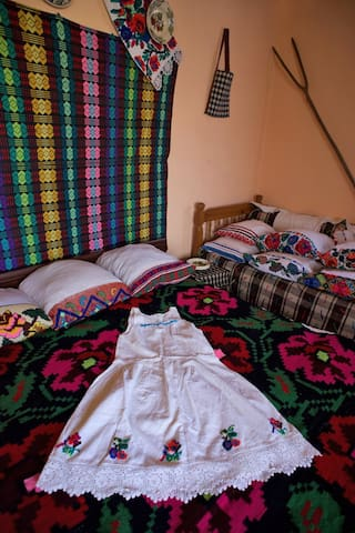 Traditional wall hangings, bed spreads, cushion covers and emboidered under skirt in our Triple Room