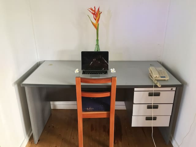 There's a desk nestled into the side of the living room in case you need to get some work done while you're here.