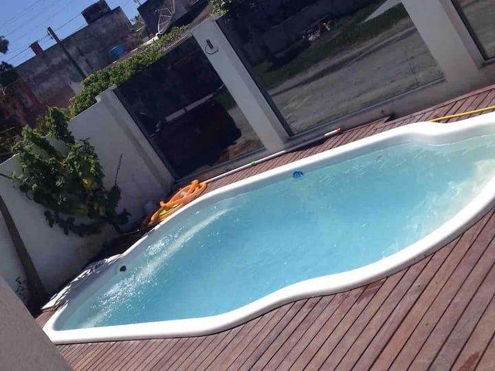 Casa com piscina na praia do Cassino
